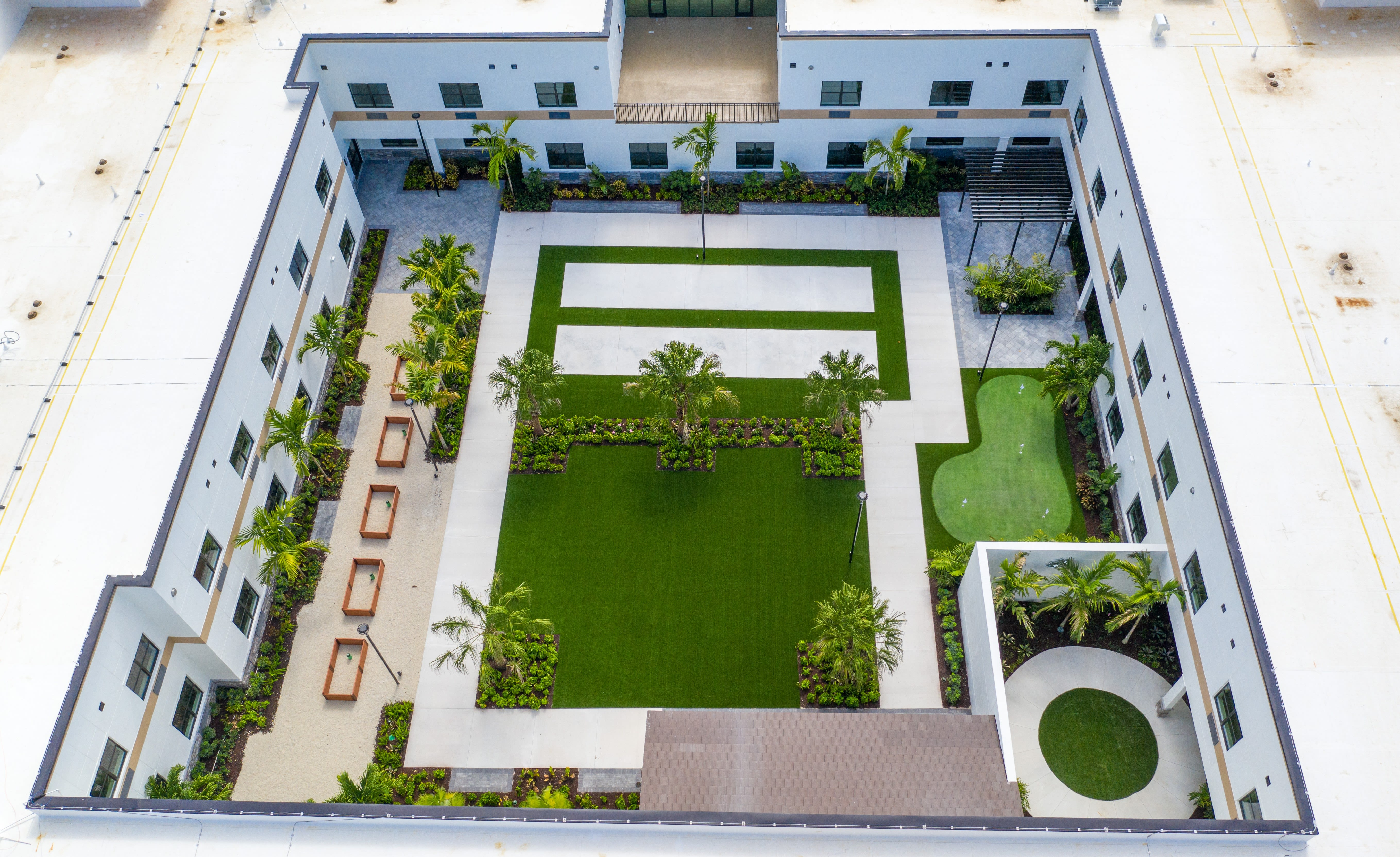 Overhead angle of courtyard and amenities at Inspired Living Royal Palm Beach in Royal Palm Beach, Florida.