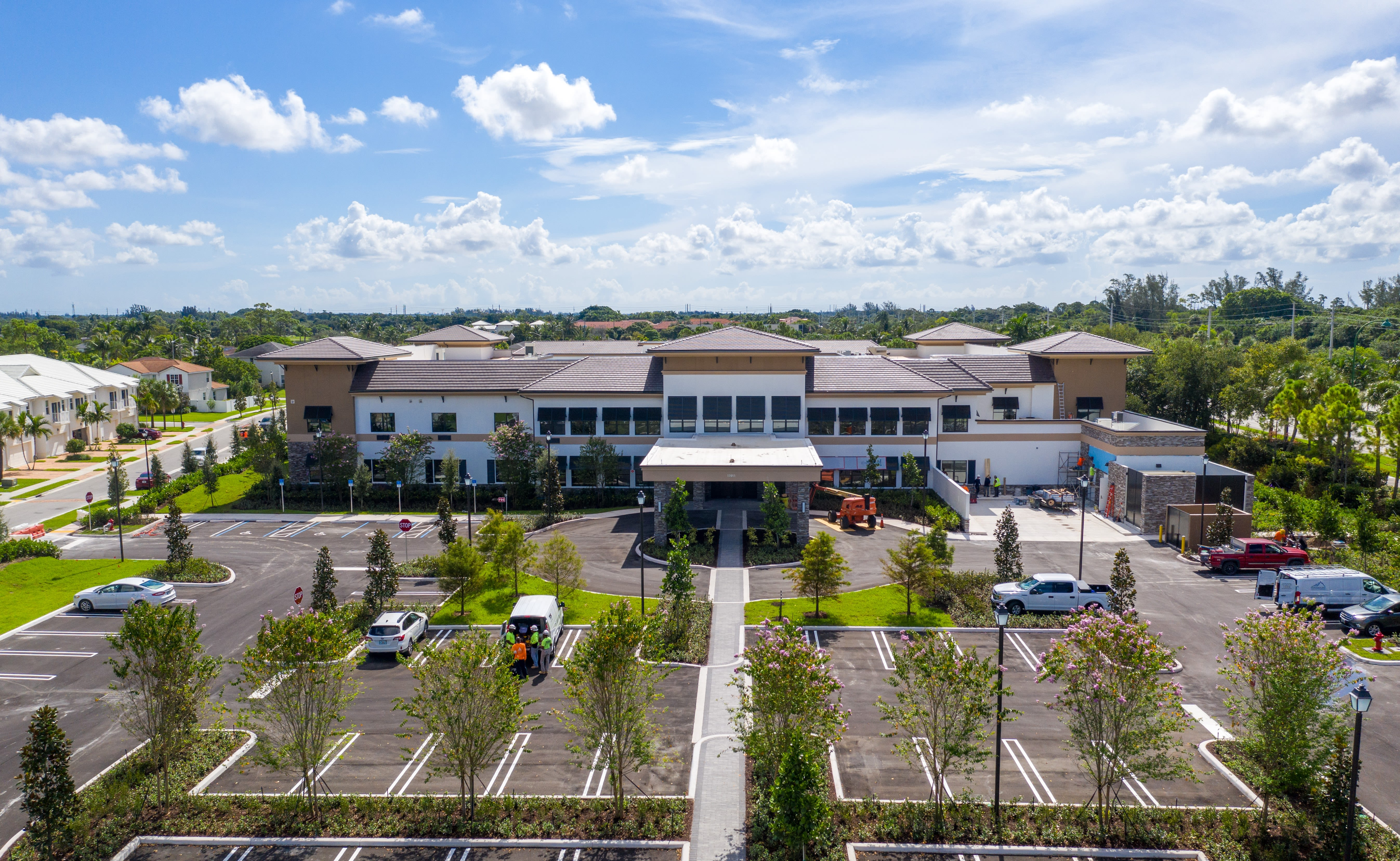 Exterior photo of the new community at Inspired Living Royal Palm Beach in Royal Palm Beach, Florida.