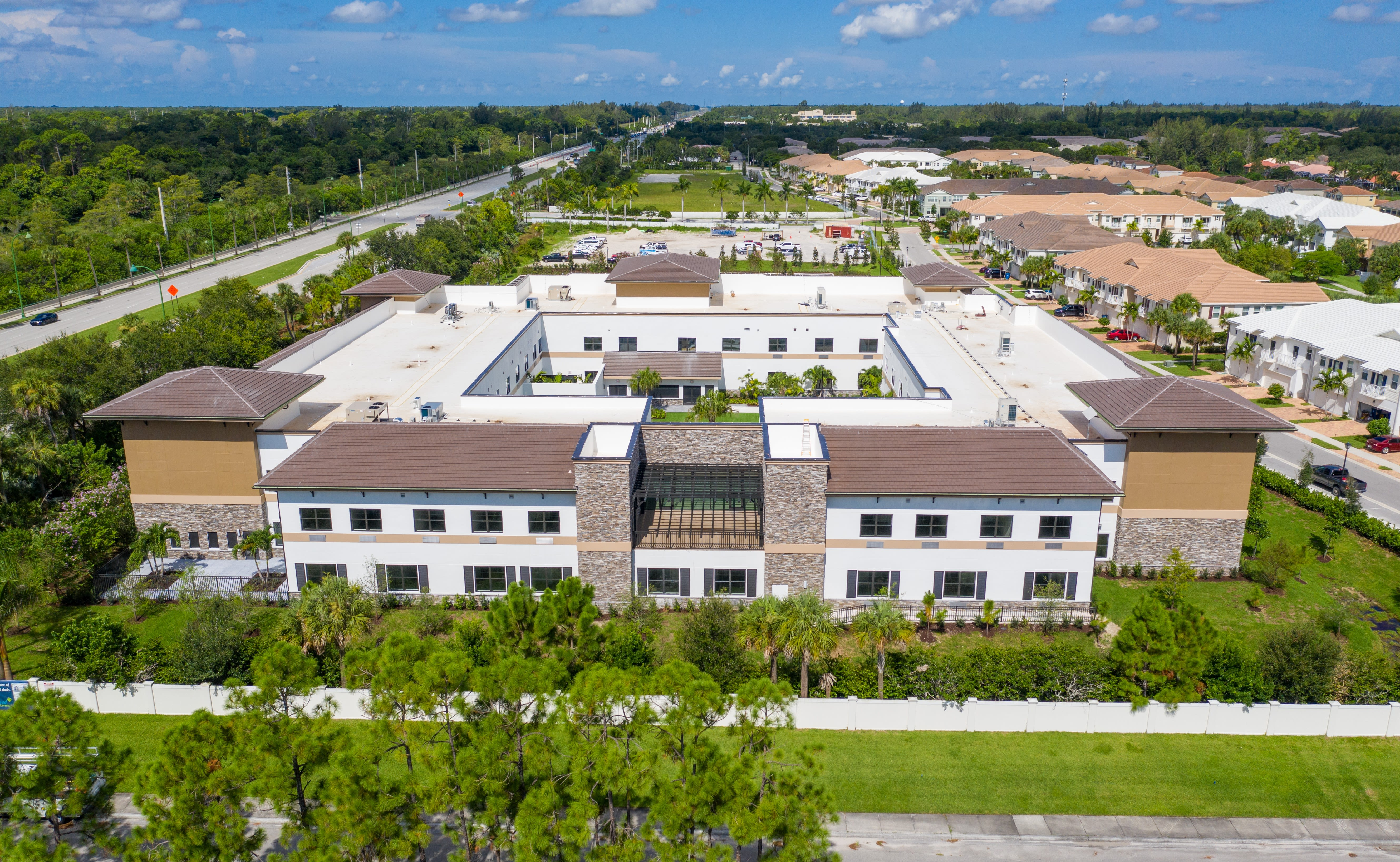 Back exterior angle of the new community at Inspired Living Royal Palm Beach in Royal Palm Beach, Florida.