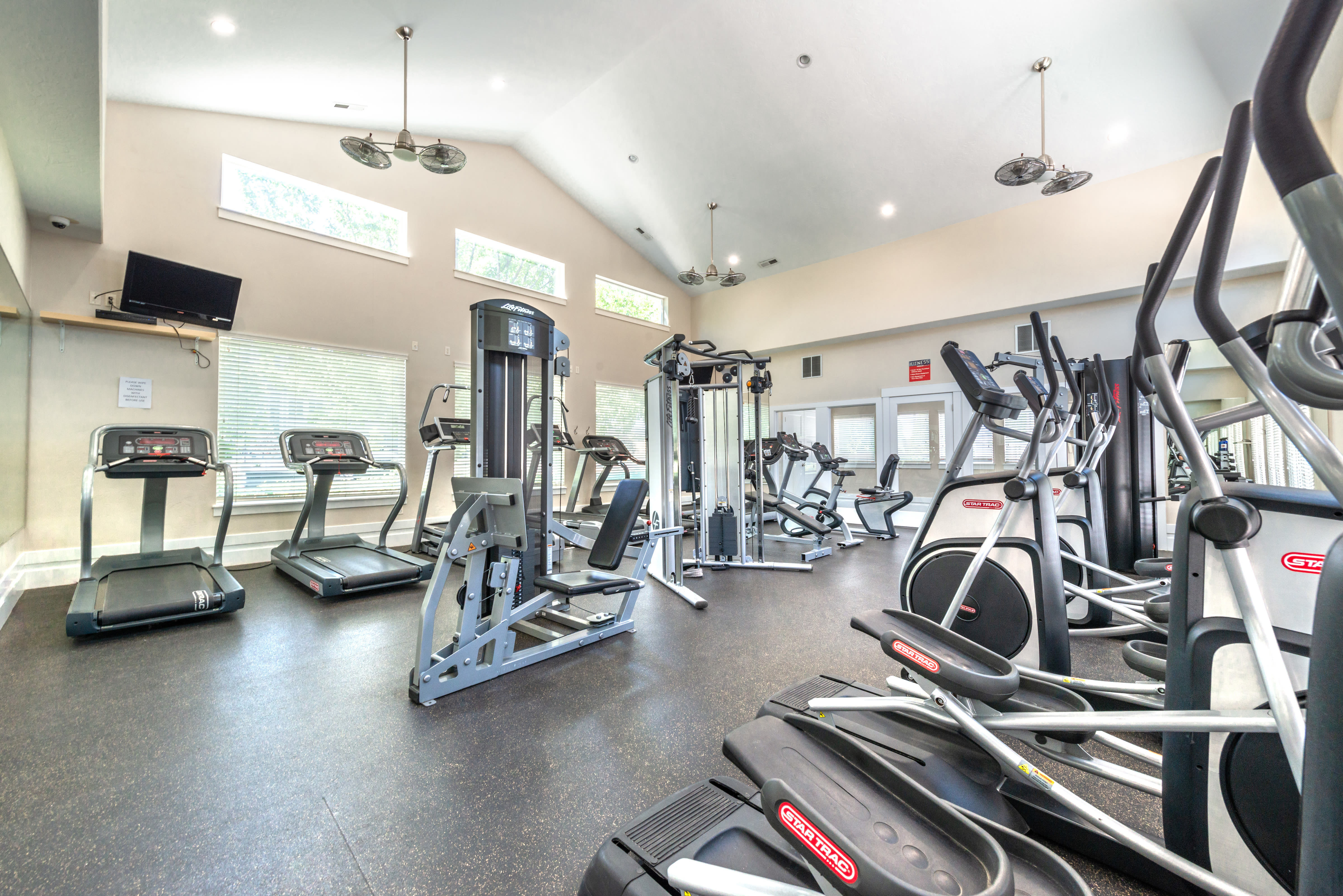 Fitness center featuring modern equipment at Olympus at the District in South Jordan, Utah