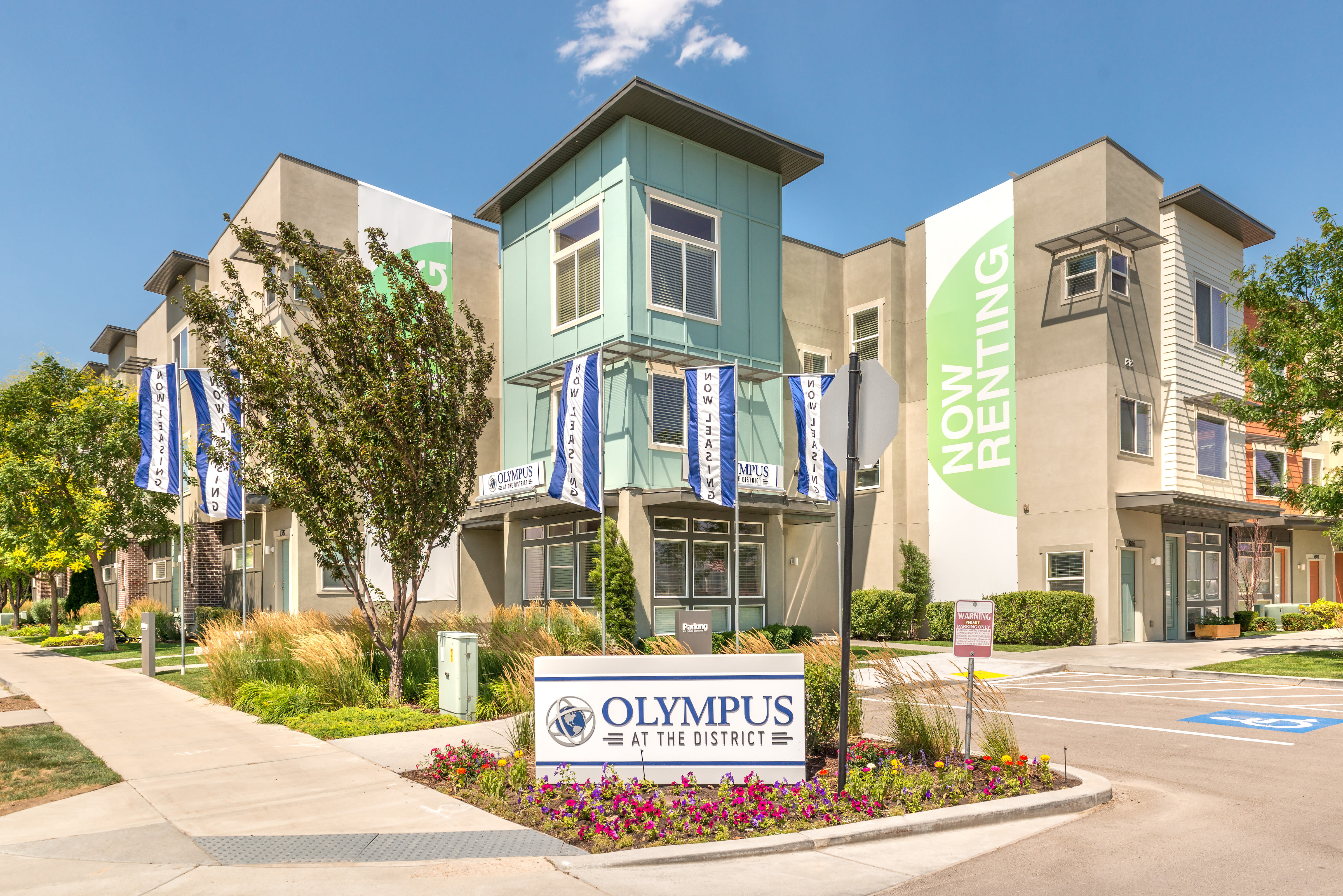 Community entrance sign at Olympus at the District in South Jordan, Utah