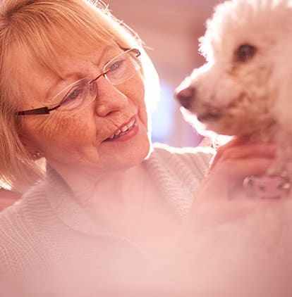 A woman with a poodle at Clearwater at North Tustin in Santa Ana, California