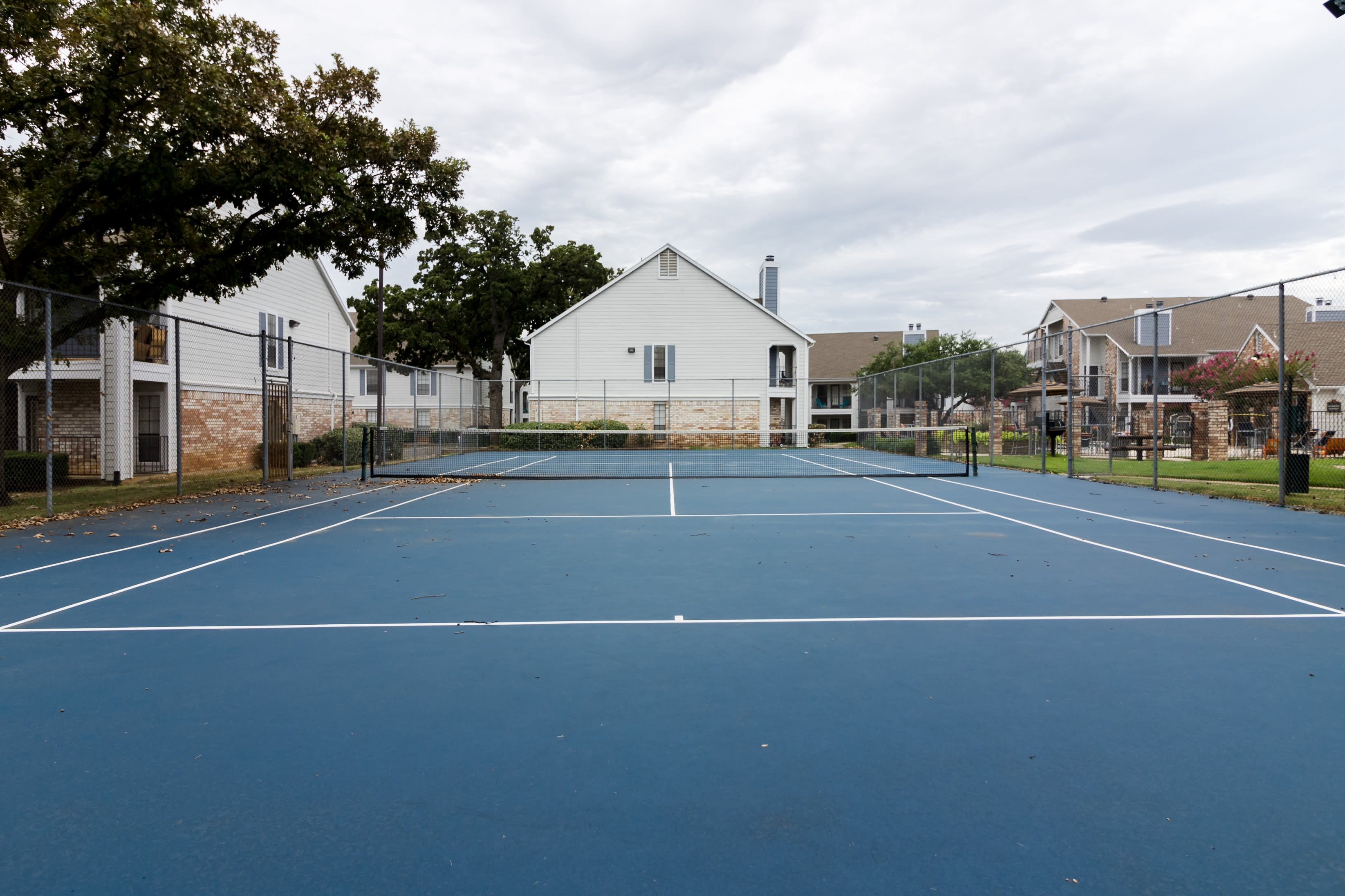 Tennis court for residents at The Logan in Bedford, Texas