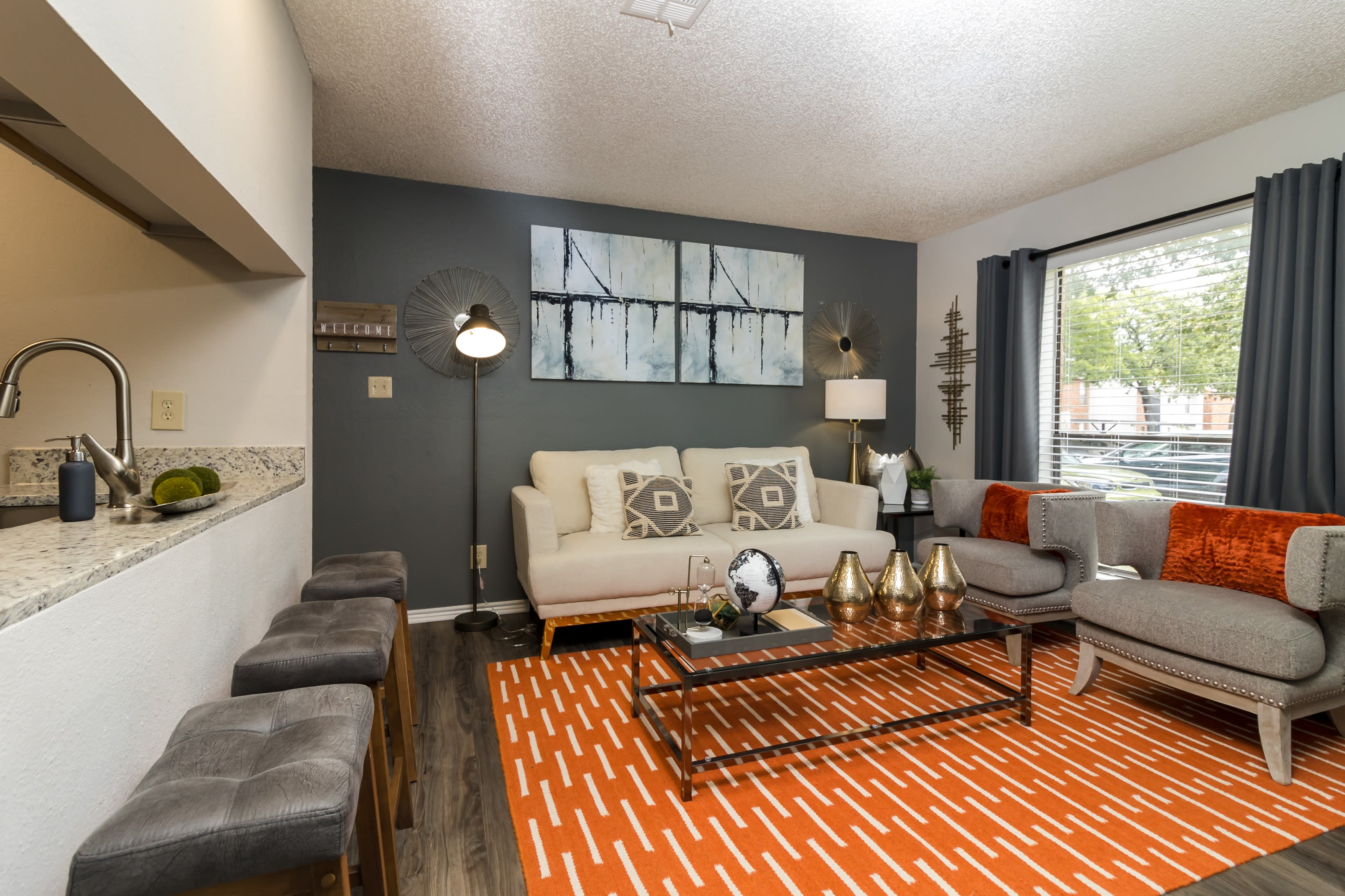 Living room with tons of natural light at The Logan in Bedford, Texas