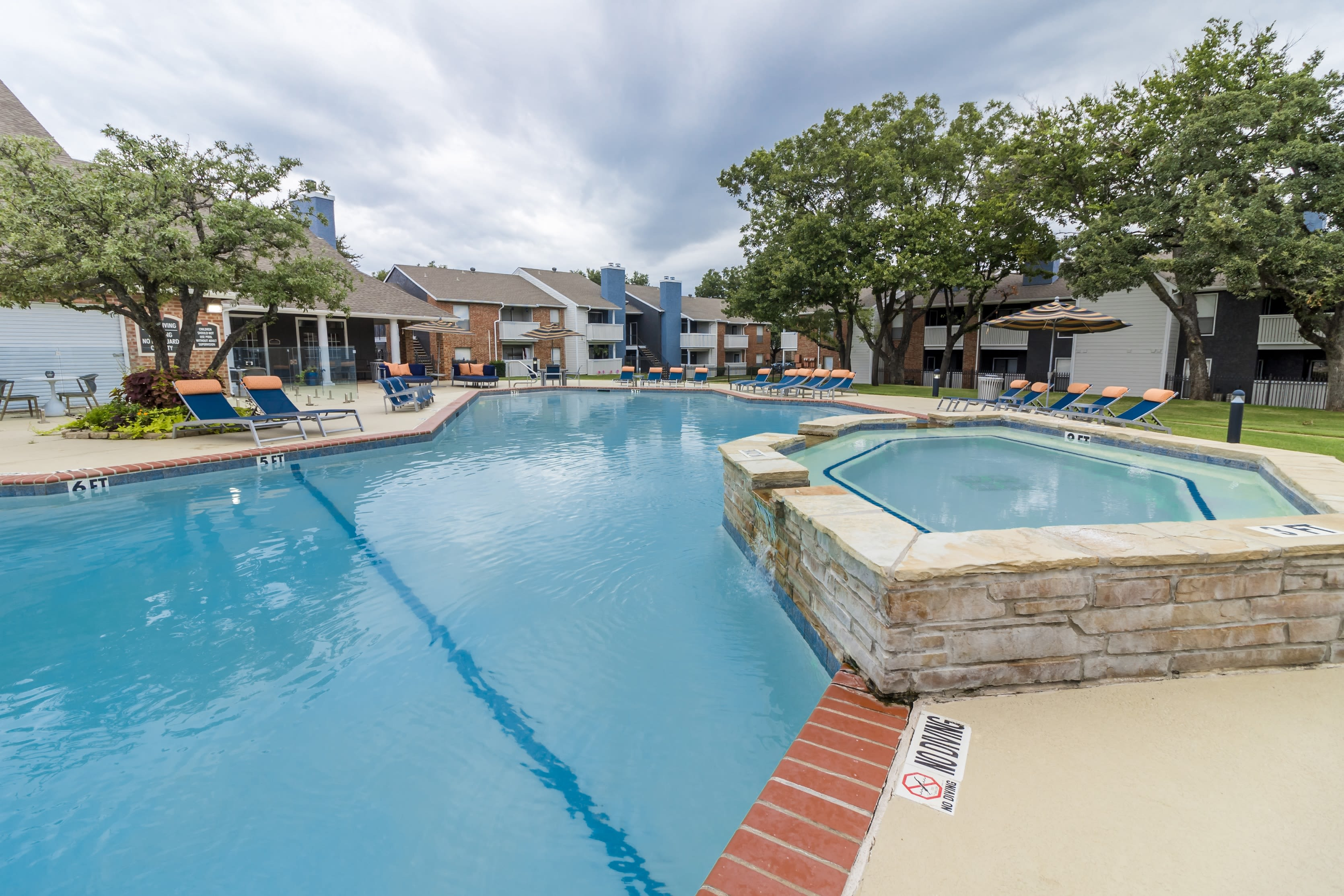 Resort style pool with hot tub at The Logan in Bedford, Texas