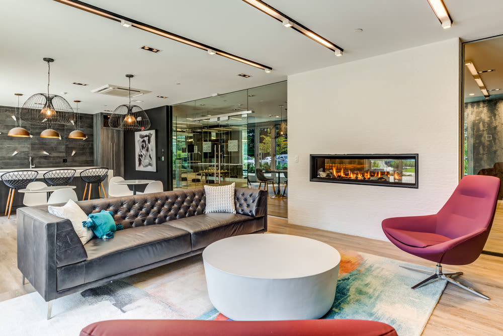 Lounge Next to Fireplace at North Square Apartments at The Mill District in Amherst, Massachusetts