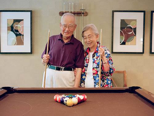 Seniors playing billiards at Merrill Gardens at Brentwood in Brentwood, California
