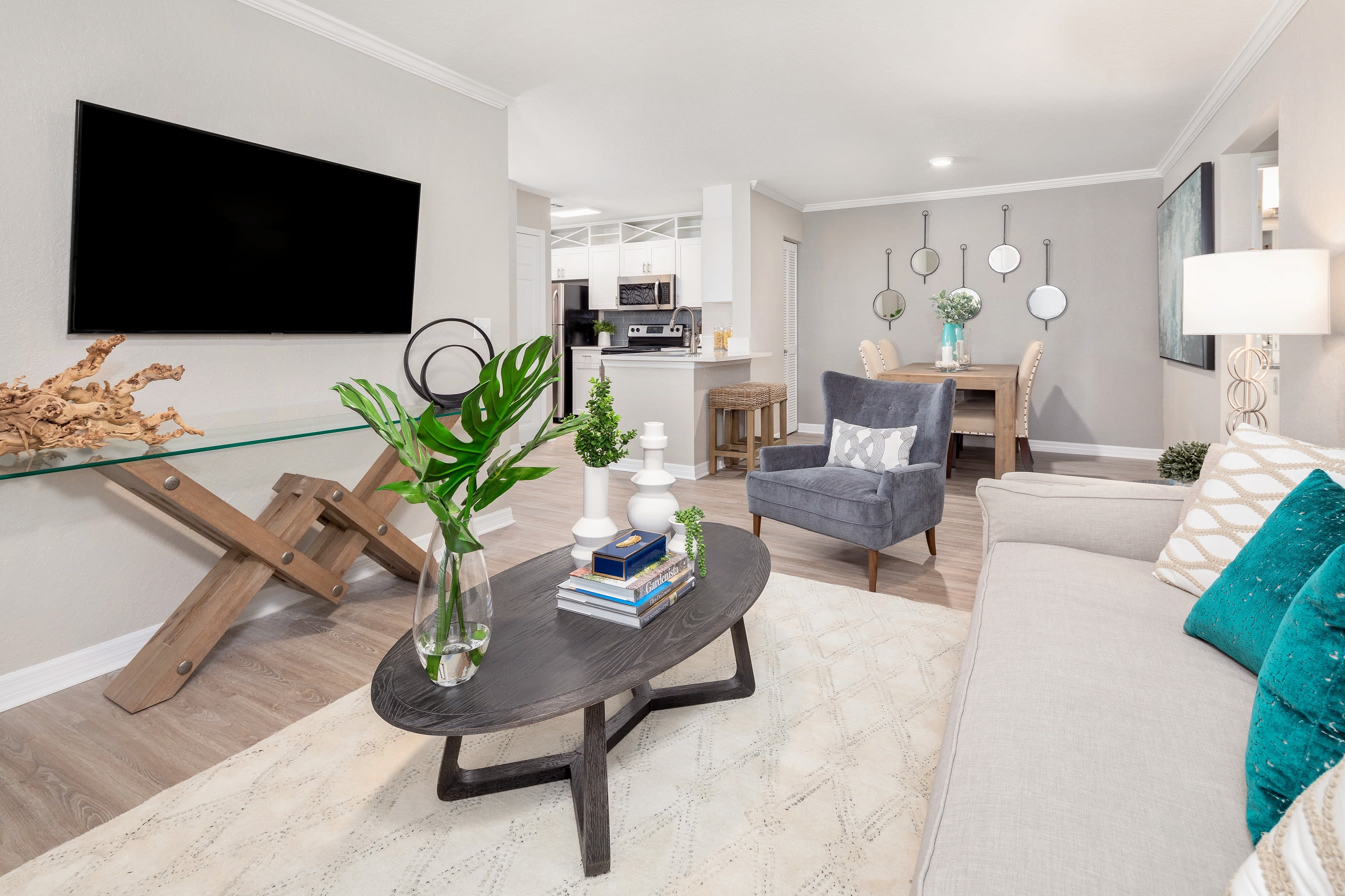 Spacious and well-furnished open-concept model home's living area at Amira at Westly in Tampa, Florida
