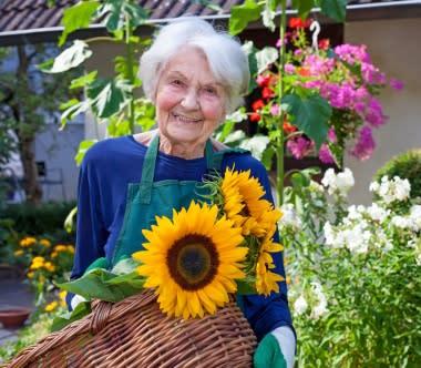 Senior enjoying the garden at Regency Palms Colton in Colton, California