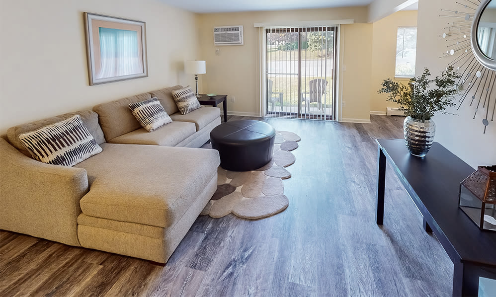 Naturally well-lit living room at Imperial Gardens Apartment Homes in Middletown, NY