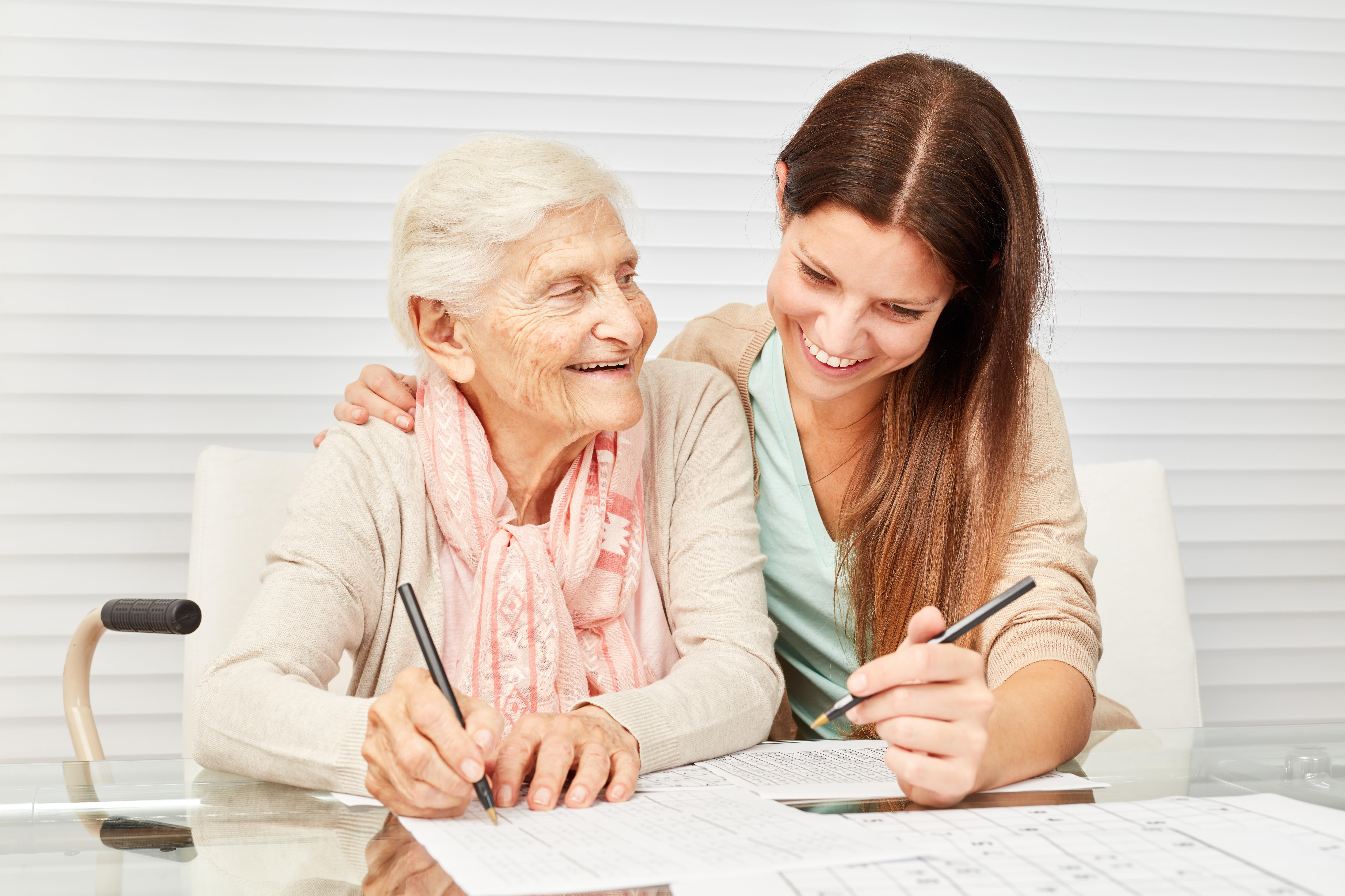 Resident and caretaker holding hands at Anthology Senior Living in Denver, Colorado