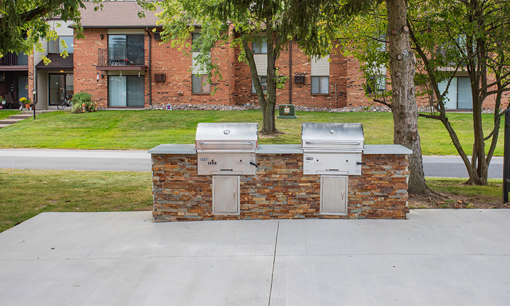 Grill stations at Webster Manor Apartments in Webster, New York