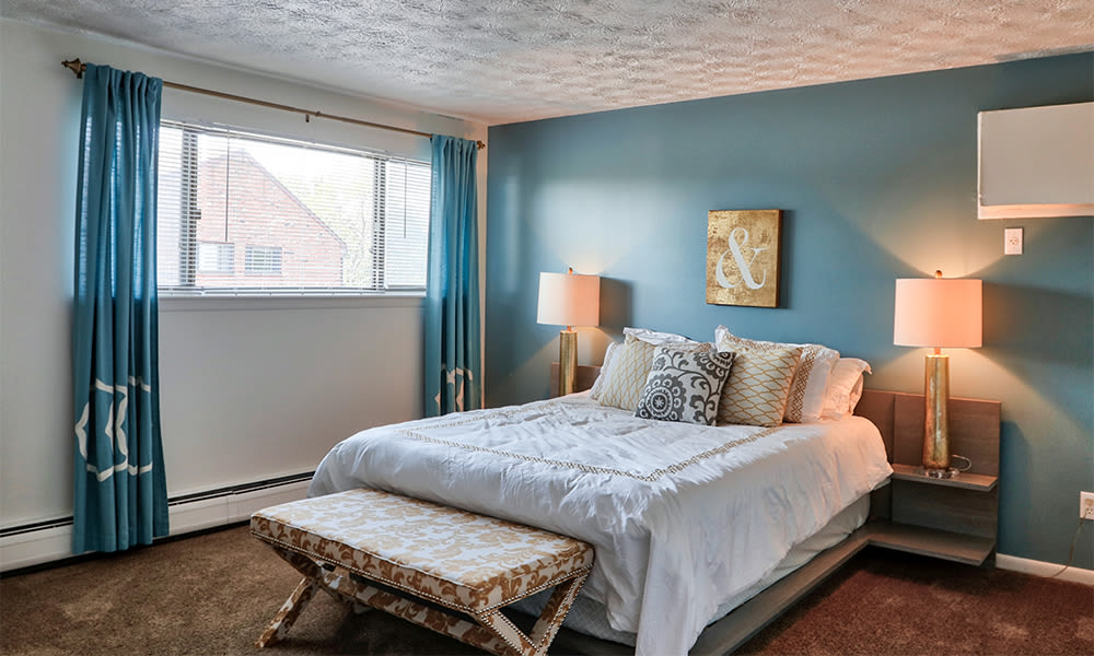 Cozy bedroom at Webster Manor Apartments in Webster, New York