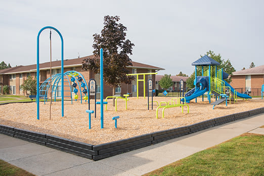 Playground at Creek Hill Apartments' buildings in Webster, New York