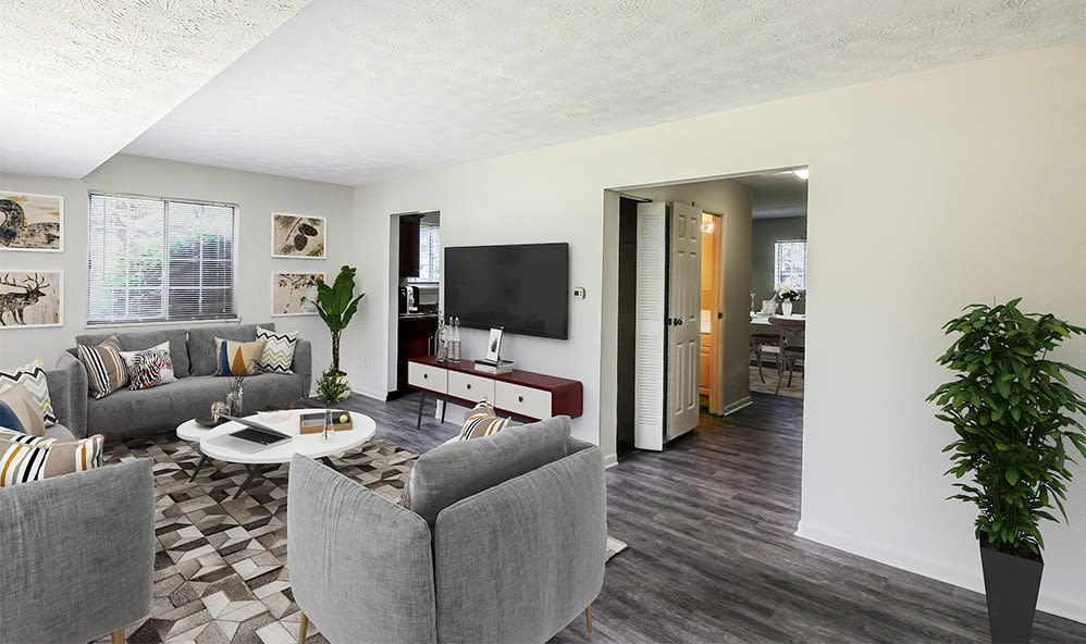 Living Room with wood-like flooring at Waverlywood Apartments & Townhomes in Webster, New York