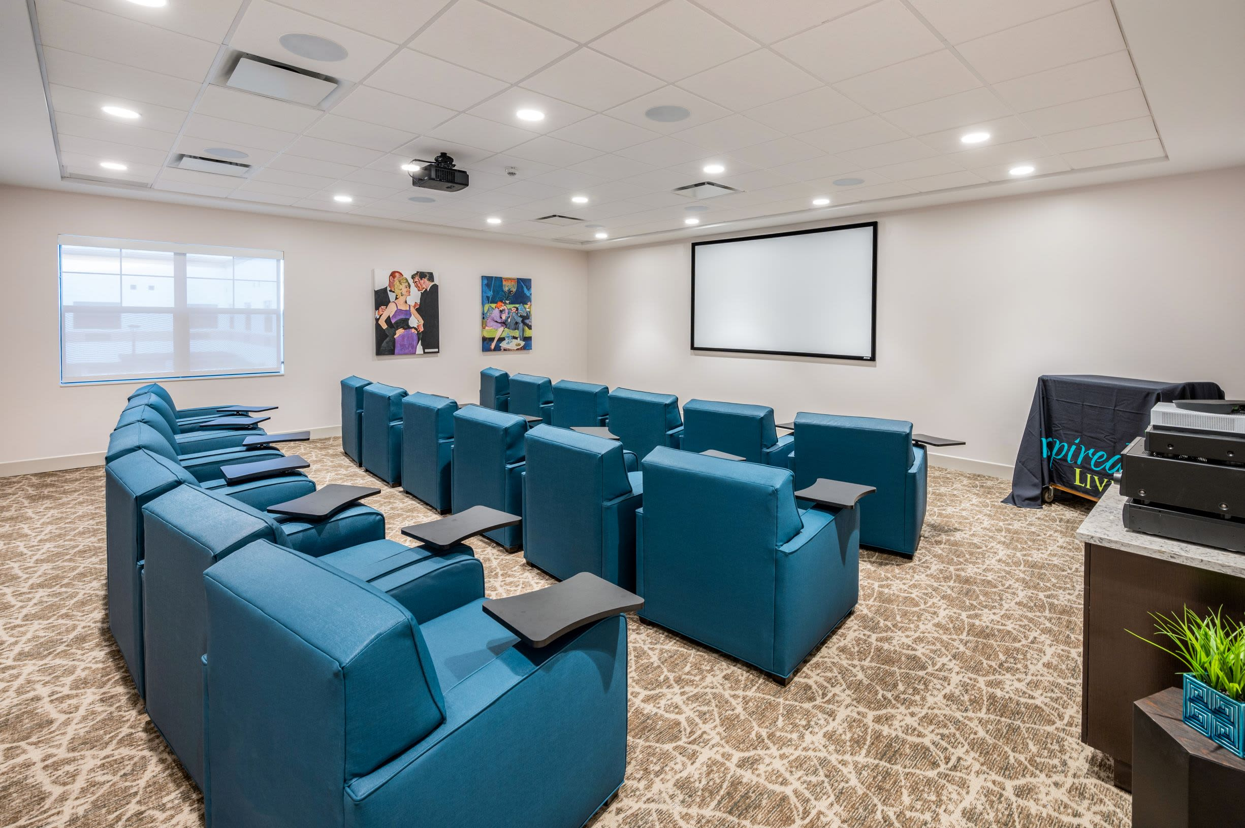 Movie Theatre at Inspired Living Royal Palm Beach in Royal Palm Beach, Florida.