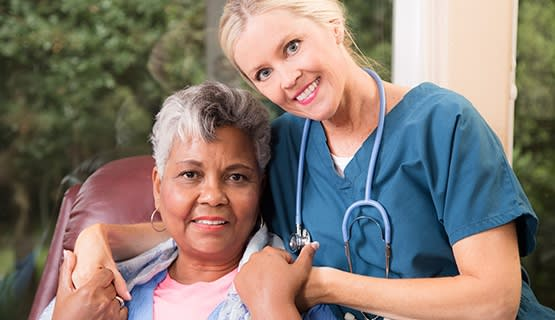 Smiling resident and care worker at Grand Villa of Palm Coast in Palm Coast, Florida