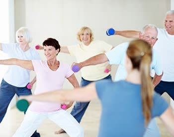 Group of our residents exercising at Grand Villa of Palm Coast in Palm Coast, Florida.
