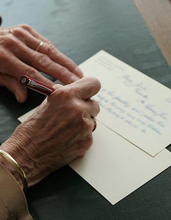 Senior making payment arrangements for Grand Villa of Palm Coast in Palm Coast, Florida