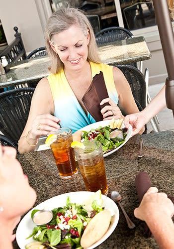 Enjoying a meal at Grand Villa of Palm Coast in Palm Coast, Florida