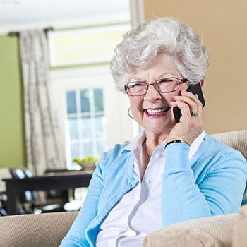 Resident on the phone at The Stilley House Senior Living in Benton, Kentucky.