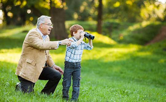 Resident and grandson looking at nature at The Stilley House Senior Living in Benton, Kentucky.