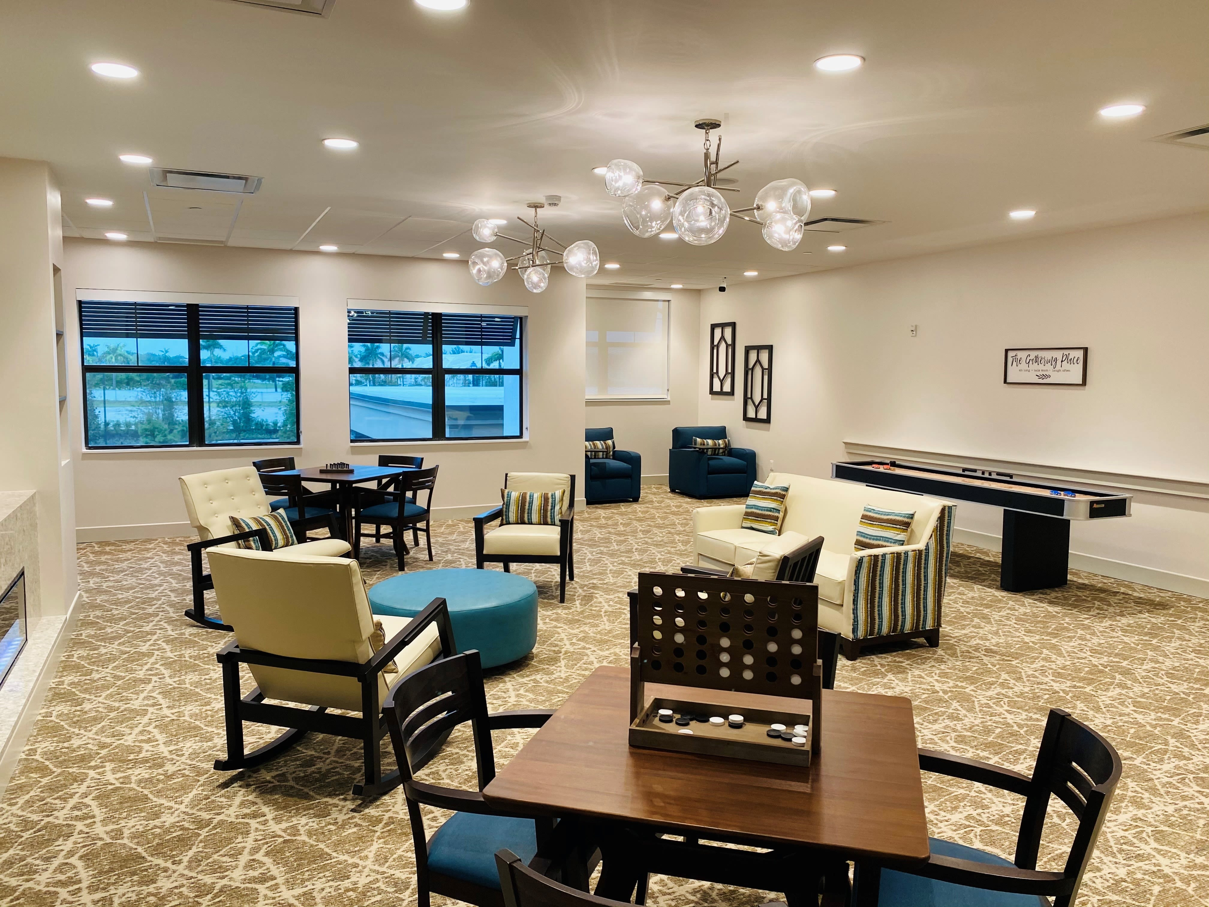 Common room at Inspired Living Delray Beach in Delray Beach, Florida.