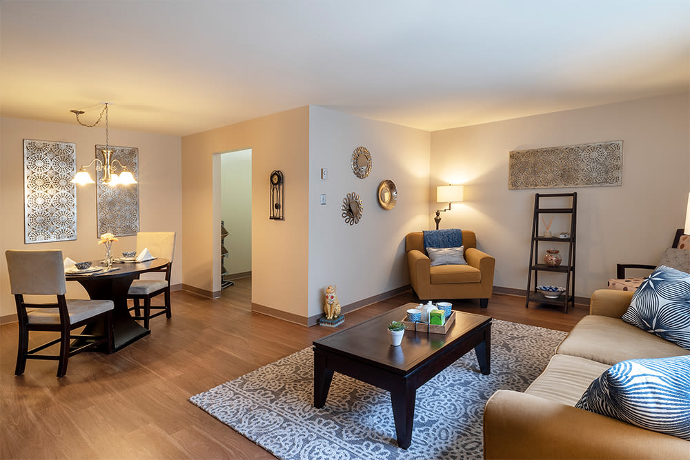 Spacious living room at Maiden Bridge & Canongate Apartments in Pittsburgh, Pennsylvania