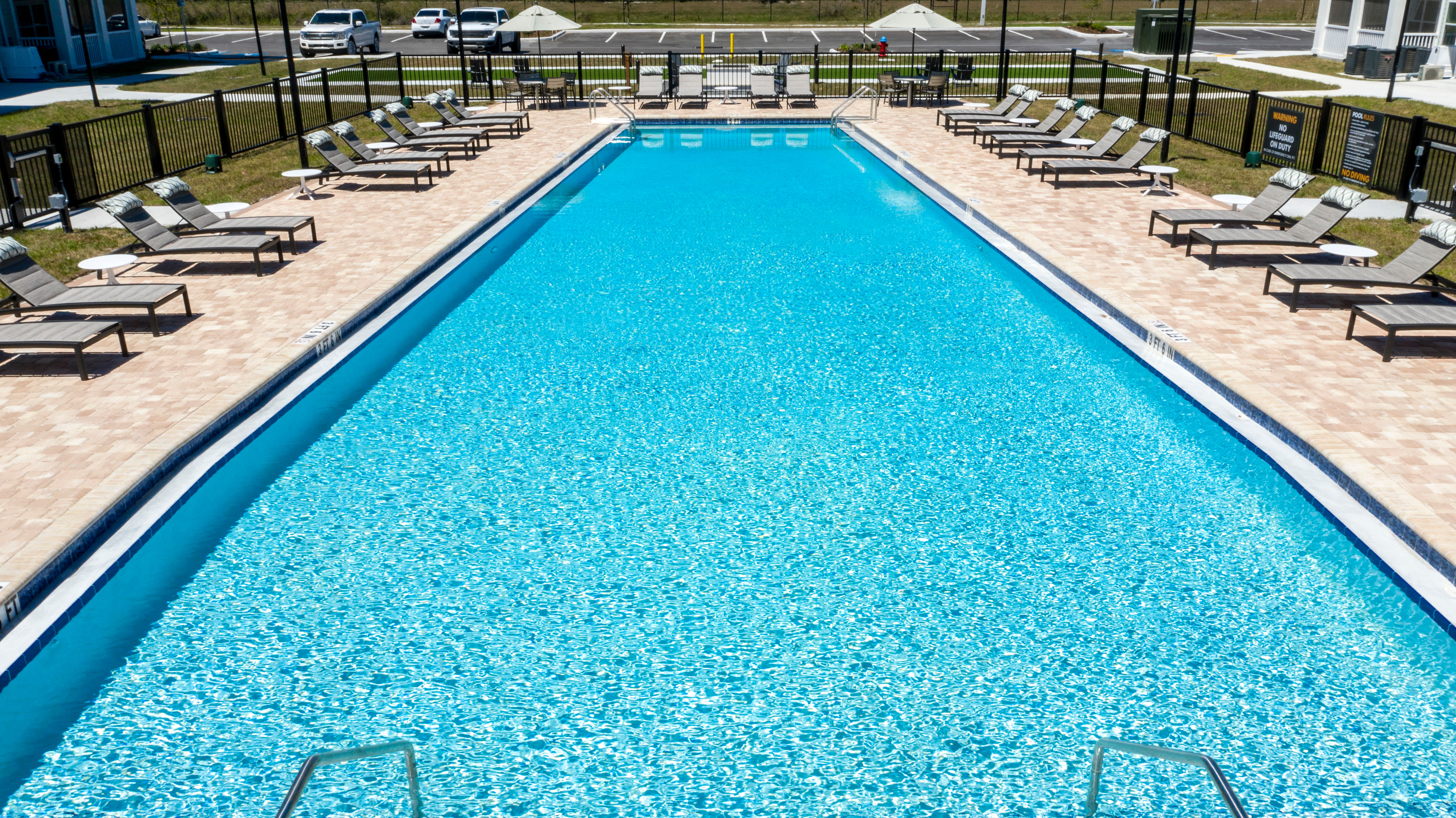 Swimming pool area on a beautiful day at Parc at Wesley Chapel in Wesley Chapel, Florida