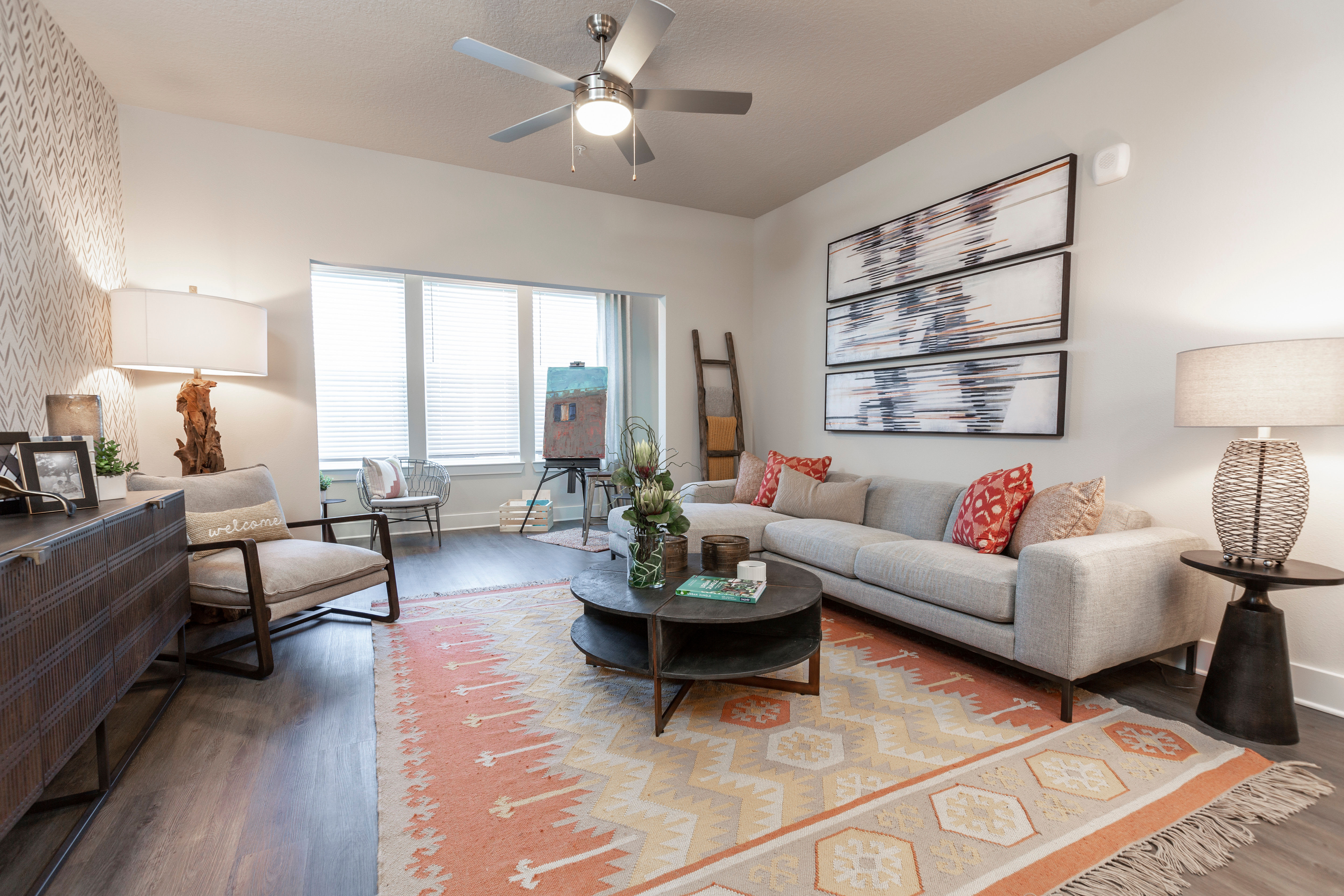 Accent wall and a ceiling fan in a model home's primary bedroom at Parc at Wesley Chapel in Wesley Chapel, Florida