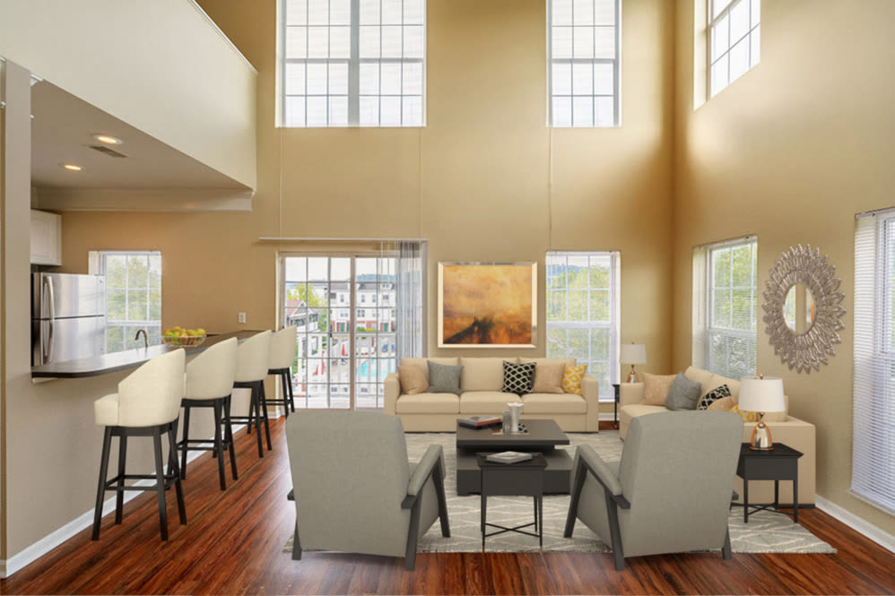 Naturally well-lit living space at The Waterfront Apartments & Townhomes in Munhall, Pennsylvania