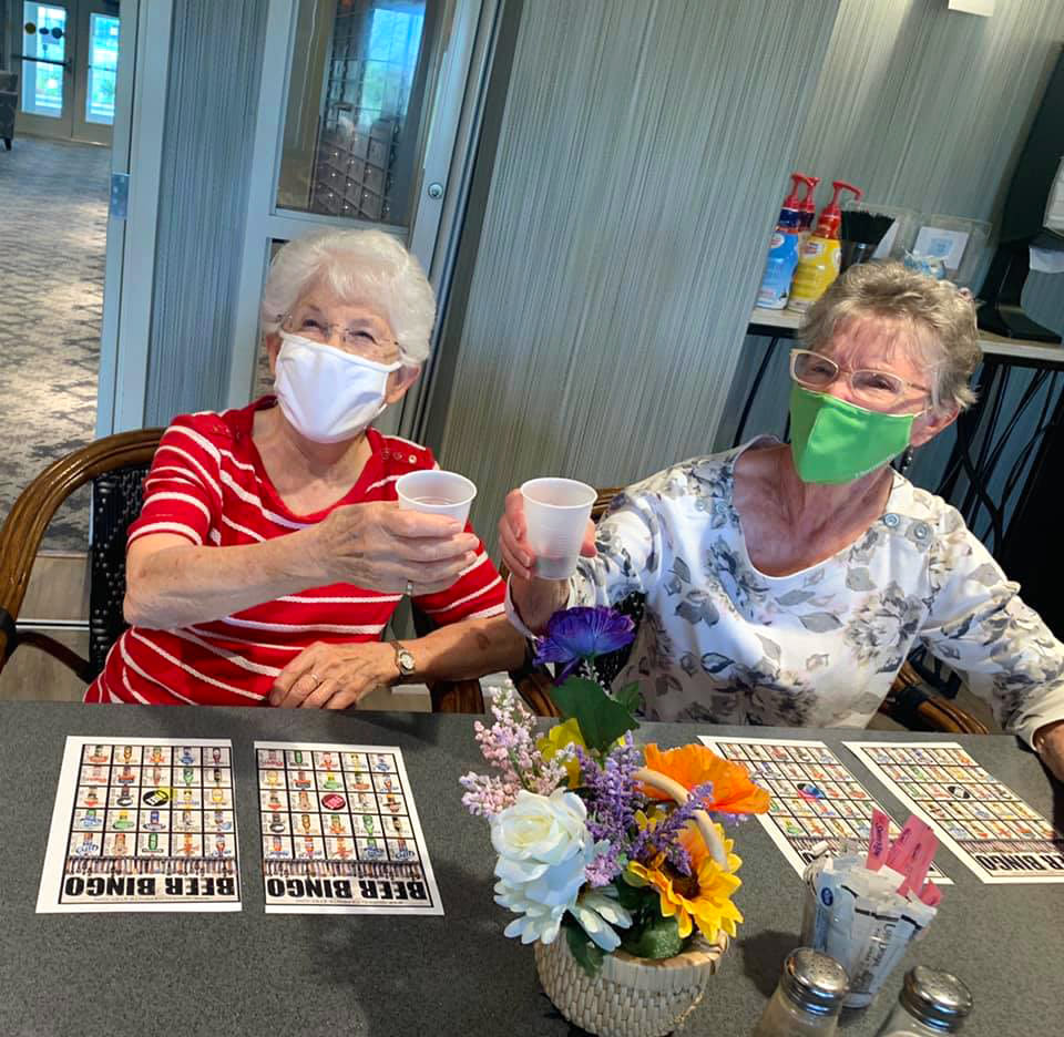residents playing bingo at Oxford Villa Active Senior Apartments in Wichita, Kansas