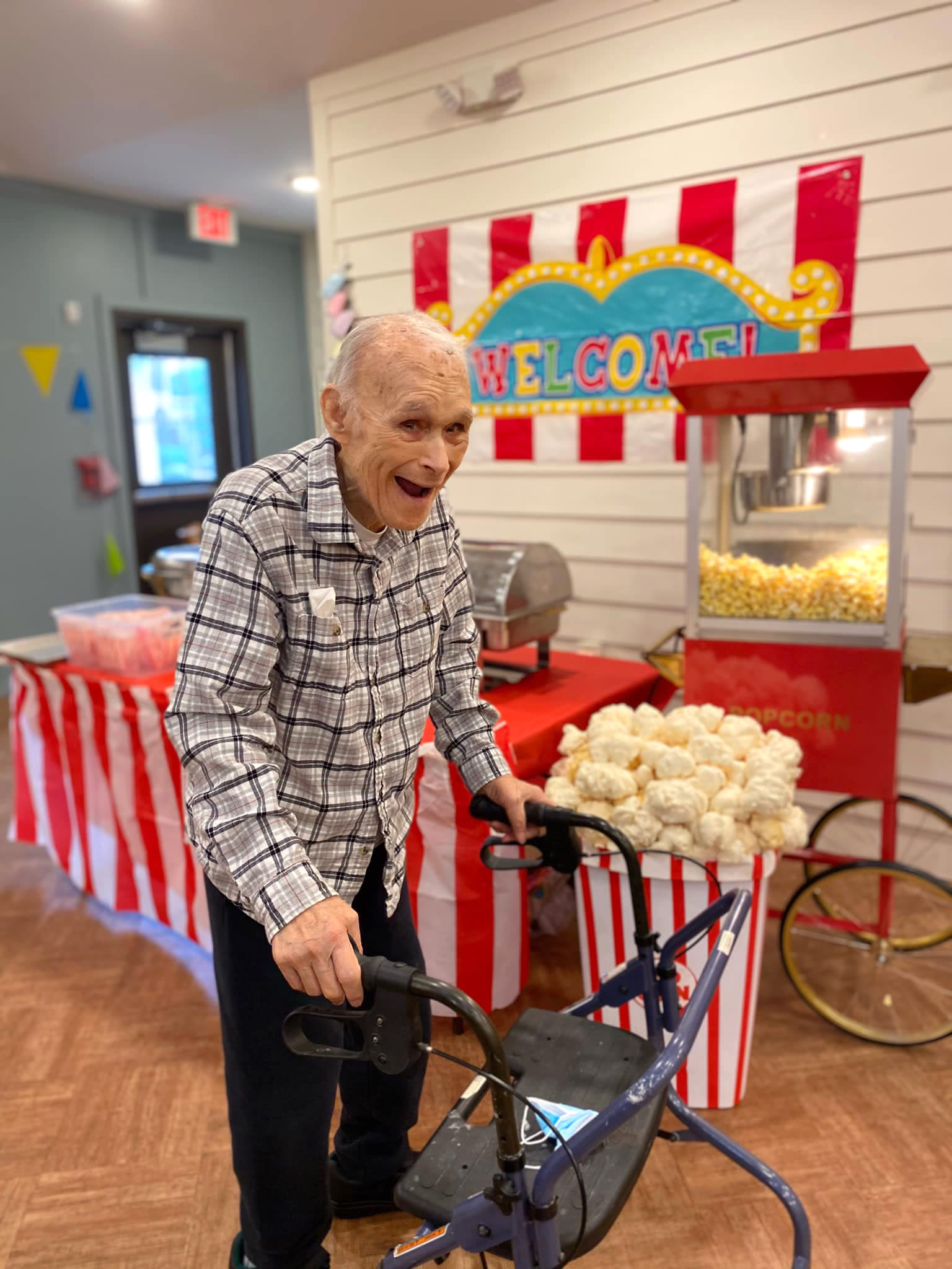 Resident at a carnival event inside Oxford Glen Memory Care at Carrollton in Carrollton, Texas