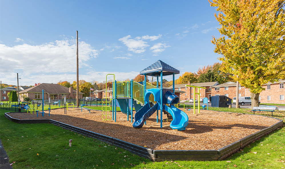 Modern playground at Knollwood Manor Apartments in Fairport, New York
