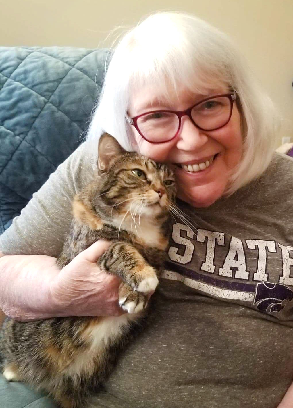 Resident holding her cat at The Oxford Grand Assisted Living & Memory Care in Wichita, Kansas