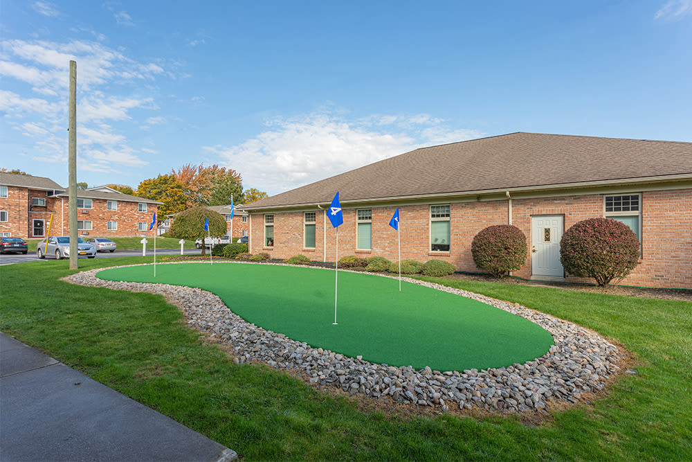 Large putting green at Perinton Manor Apartments in Fairport, New York