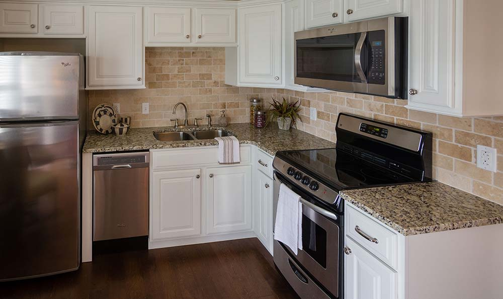 Modern kitchen with stainless-steel appliances at Field Pointe Assisted Living in Saint Joseph, Missouri