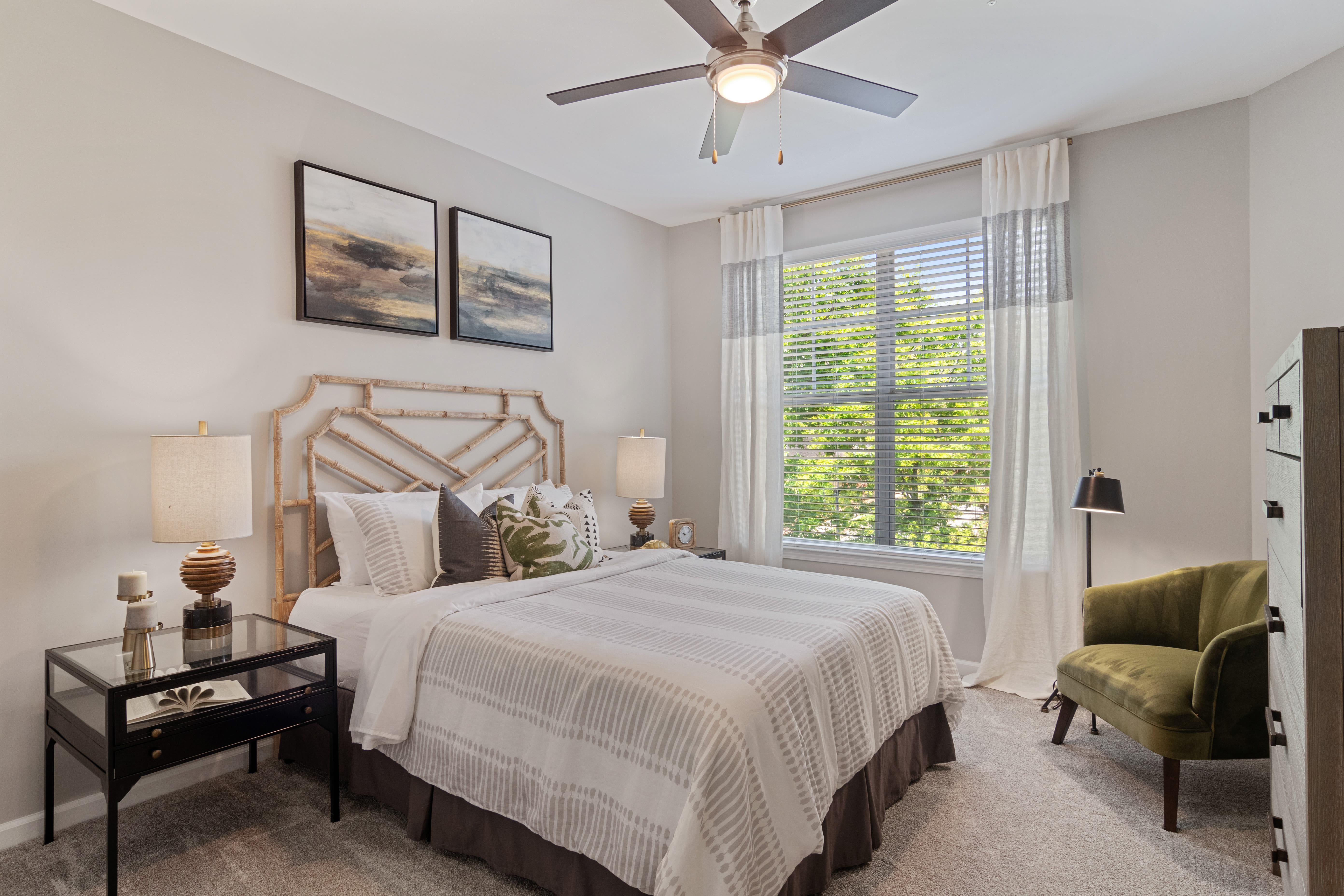 Spacious bedroom with ceiling fan at Emblem Alpharetta in Alpharetta, Georgia