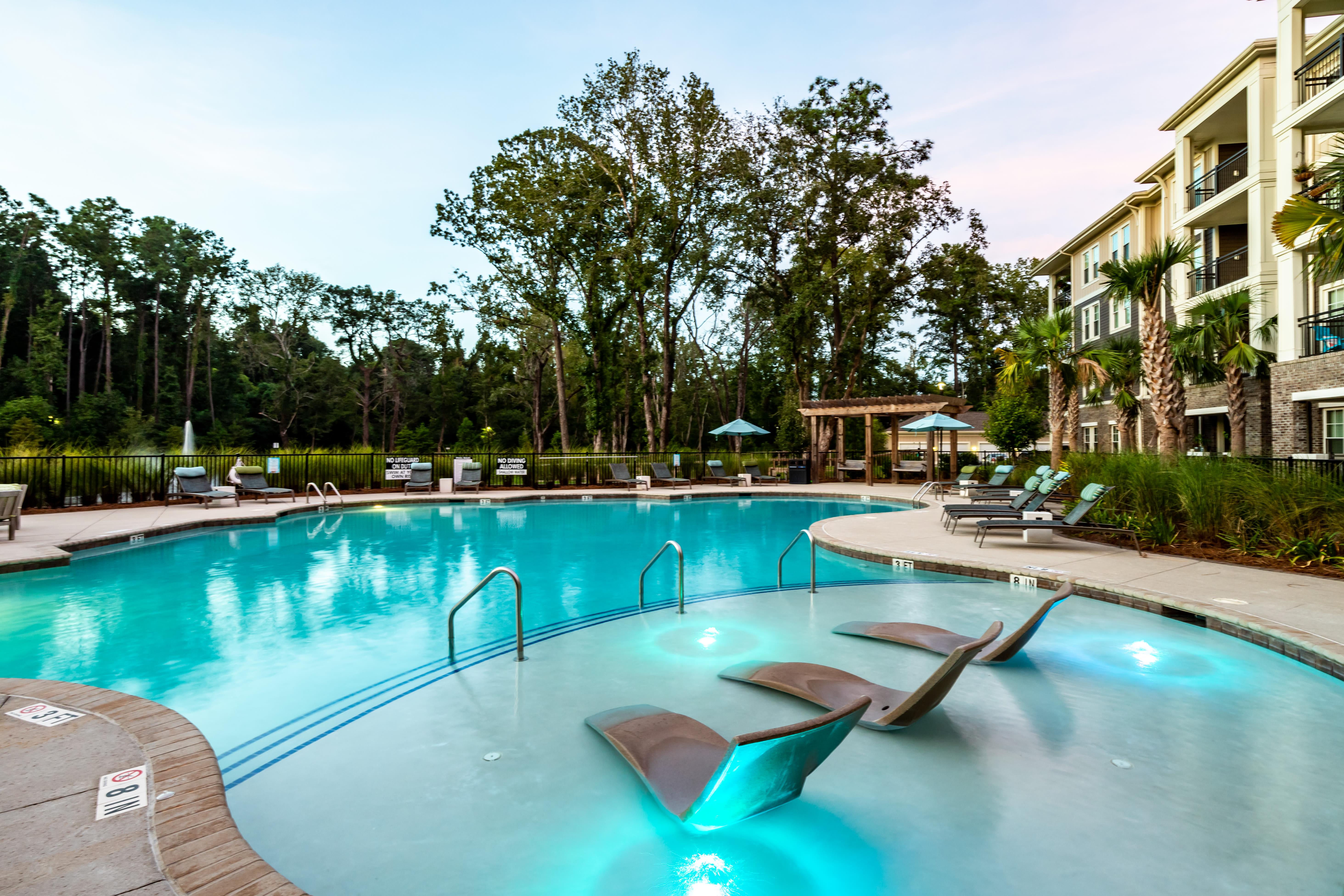 Pool with chairs at The Heyward in Charleston, South Carolina