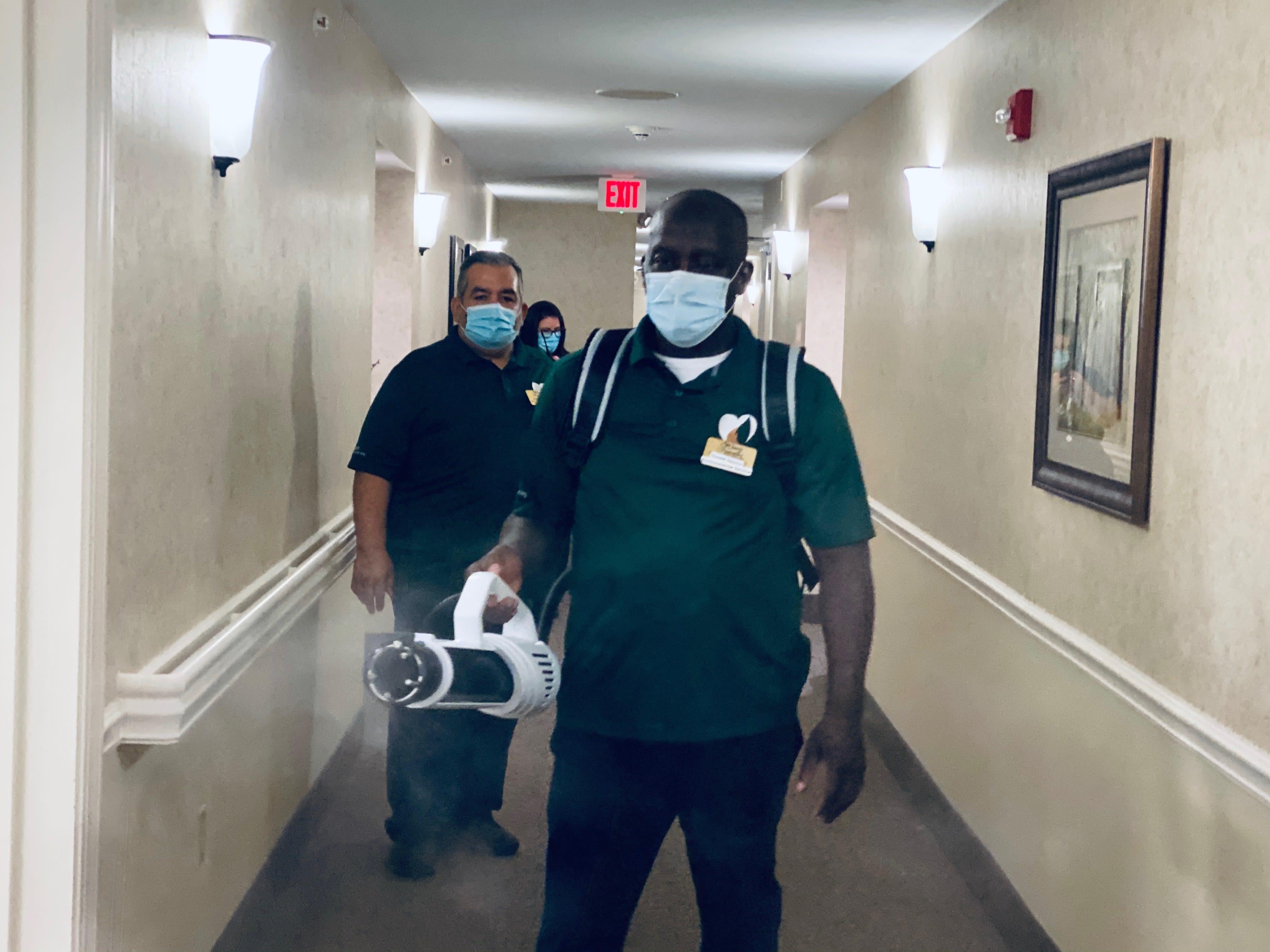 Team member spraying Total Coverage 360
