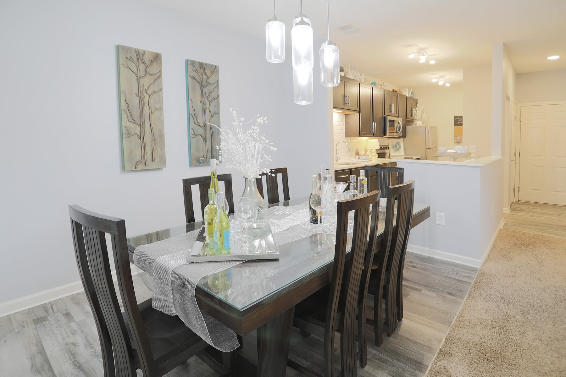 Dining room table and view of kitchen at The Landings at Beckett Ridge in West Chester, Ohio