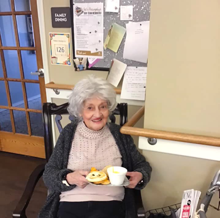 Resident with a breakfast plate at Canoe Brook Assisted Living & Memory Care in Catoosa, Oklahoma