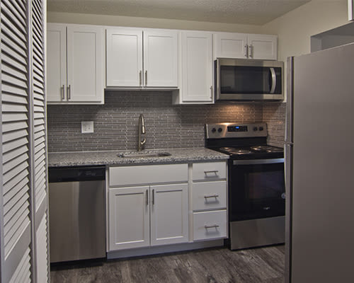 Kitchen with stylish black appliances at Westpointe Apartments in Pittsburgh, Pennsylvania