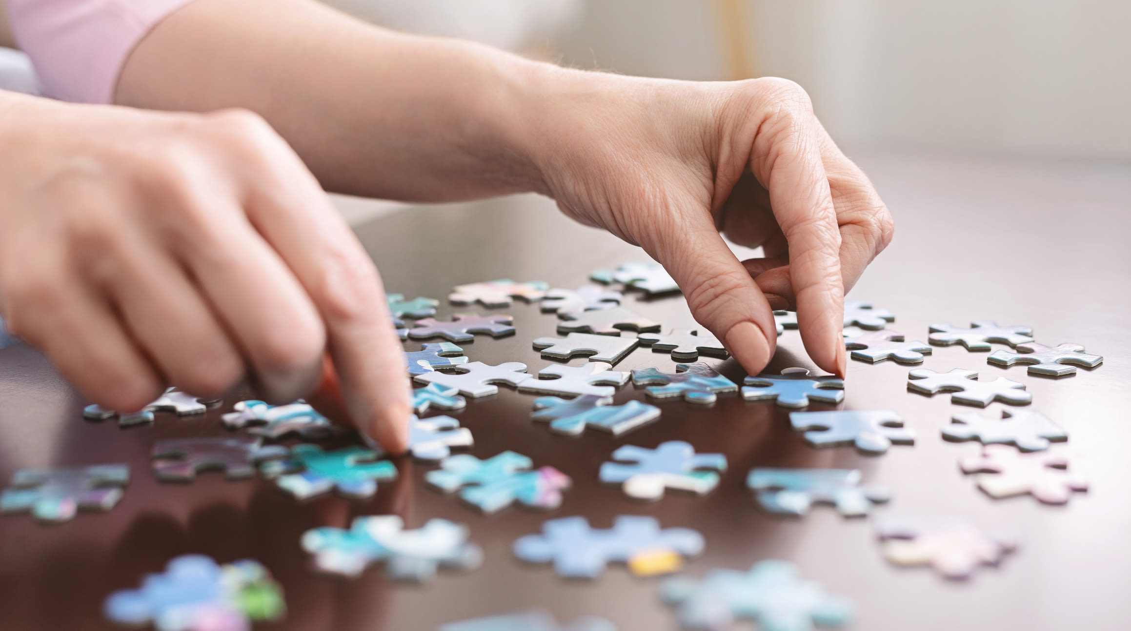 Doing a puzzle at Forest Creek Memory Care in Overland Park, Kansas