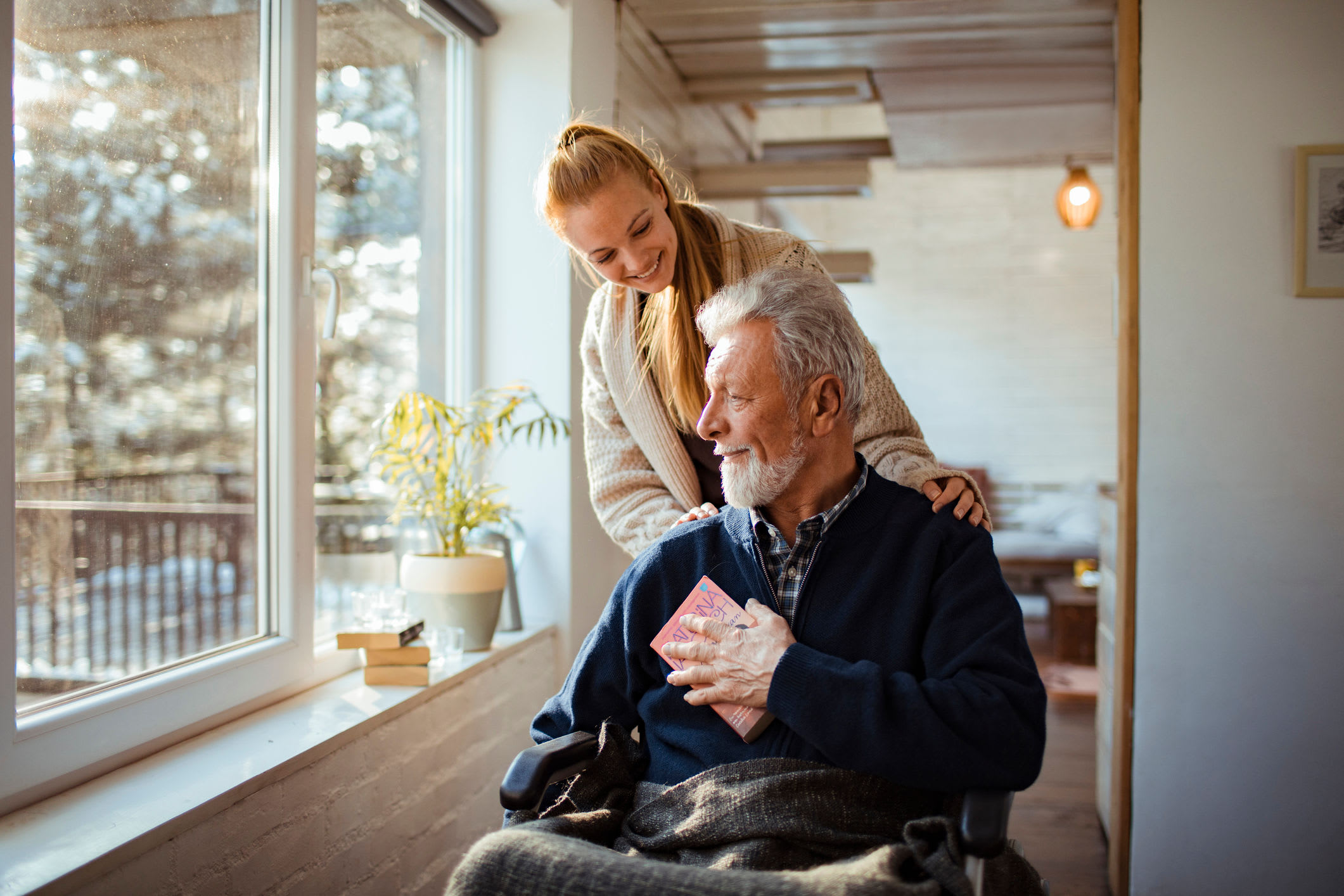 Caregiver with Resident at Forest Creek Memory Care in Overland Park, Kansas