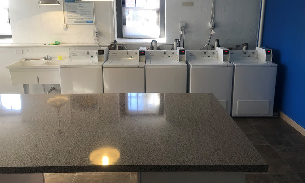 Laundry room at Hillside Gardens Apartment Homes in Nutley, New Jersey