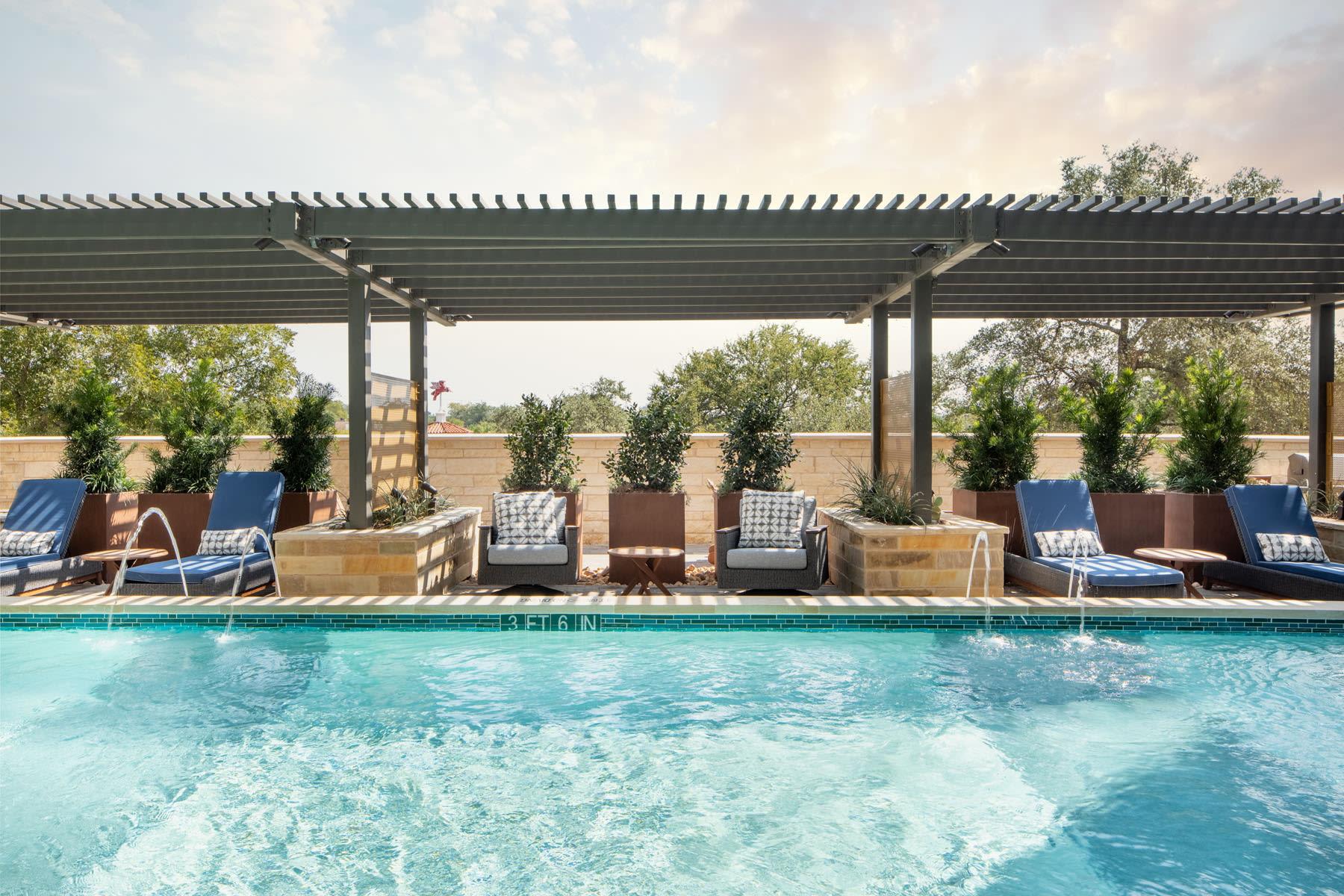 Plenty of plush seating next to the pool at Magnolia Heights in San Antonio, Texas