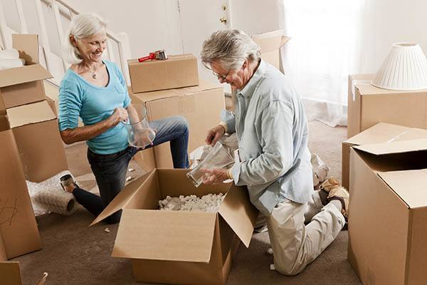A man and a women packing boxes for storage at Metro Self Storage in Coon Rapids, Minnesota
