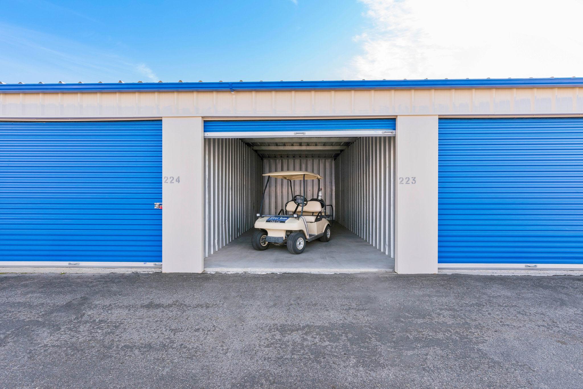 Drive up storage open with golf cart at Stor'em Self Storage in Orem, Utah