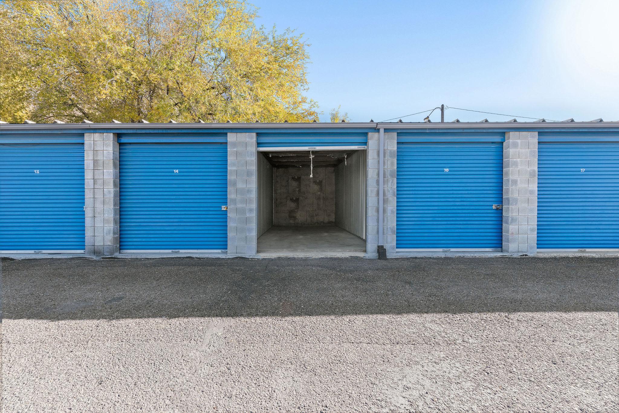 Blue doors on storage units at Stor'em Self Storage in Springville, Utah